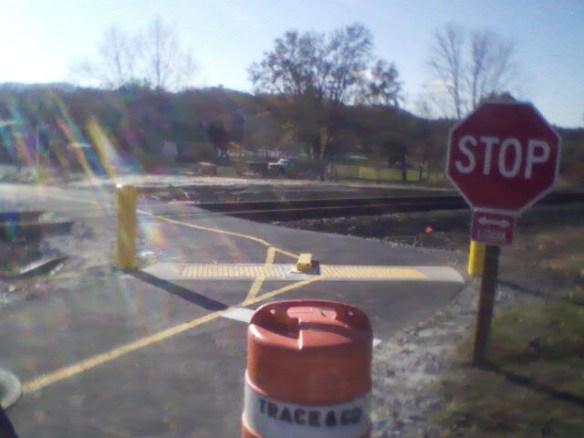Path crosses railroad tracks, then crosses road (N. Main Street)