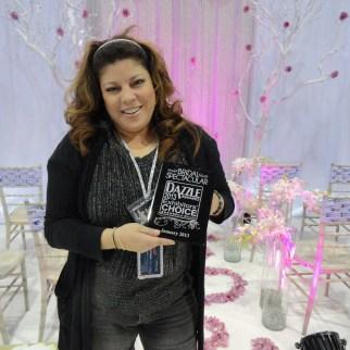 Desiree accepts Dazzle Award at Bridal Spectacular