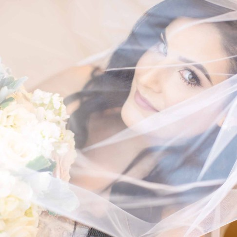 Bride with veil over face Vimana Photography