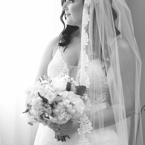 Bride looking out window at Emerald at Queensridge