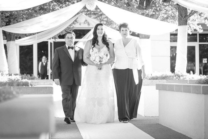 Bride with parents walking down aisle at Emerald