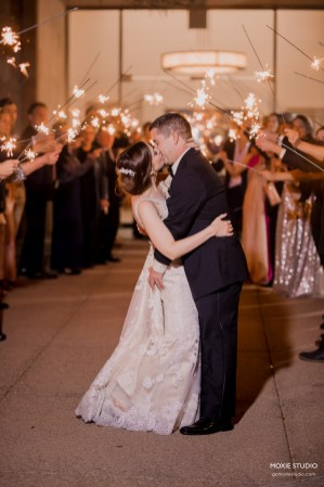 Bride and Groom kissing under sparklers at Paiute image by Moxie Studio