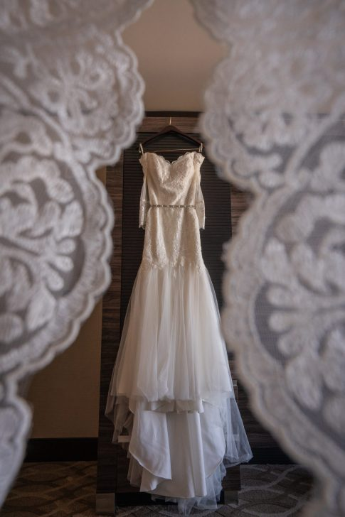wedding gown with lace over lay at a luxurious las vegas destination wedding.