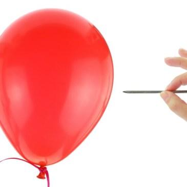 nail popping a balloon
