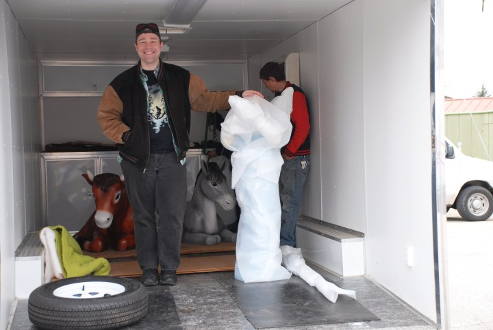 Joe and friend in back of U-Haul truck with Bronner's exclusive life-sized Nativities pieces