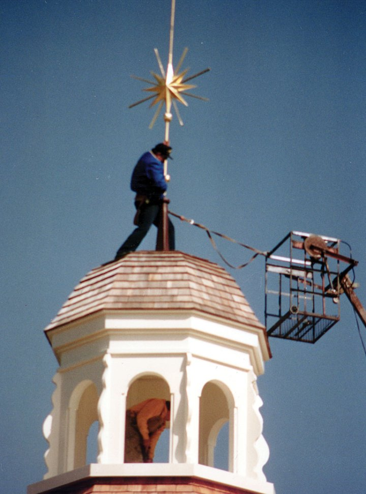 I10---putting-star-on-top-of-chapel