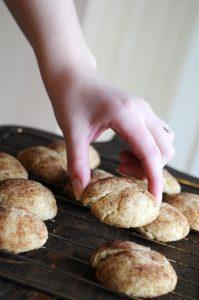 Hand Grabbing A Snickerdoodles Cookie