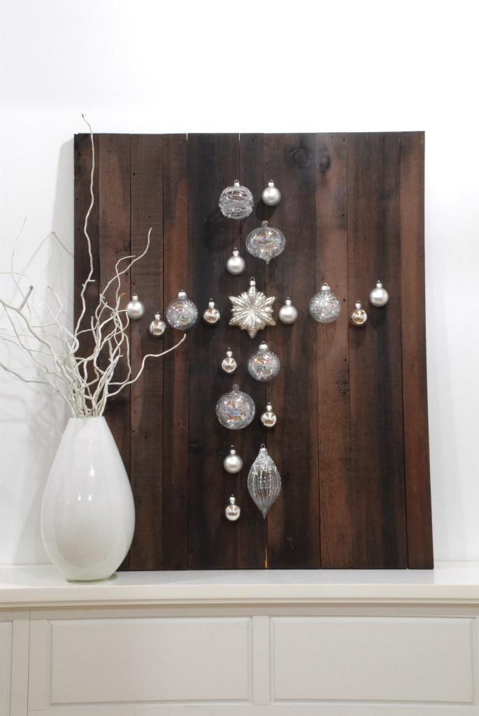 Barn Wood With Cross From Glass Christmas Ornaments And Vase Of Twigs