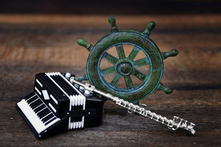 Accordion, Ships Wheel, and Flute Ornaments.