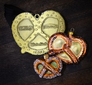 Winterlaufe, Volkslaufe, and Bruckelaufe race medal, and pretzel ornaments