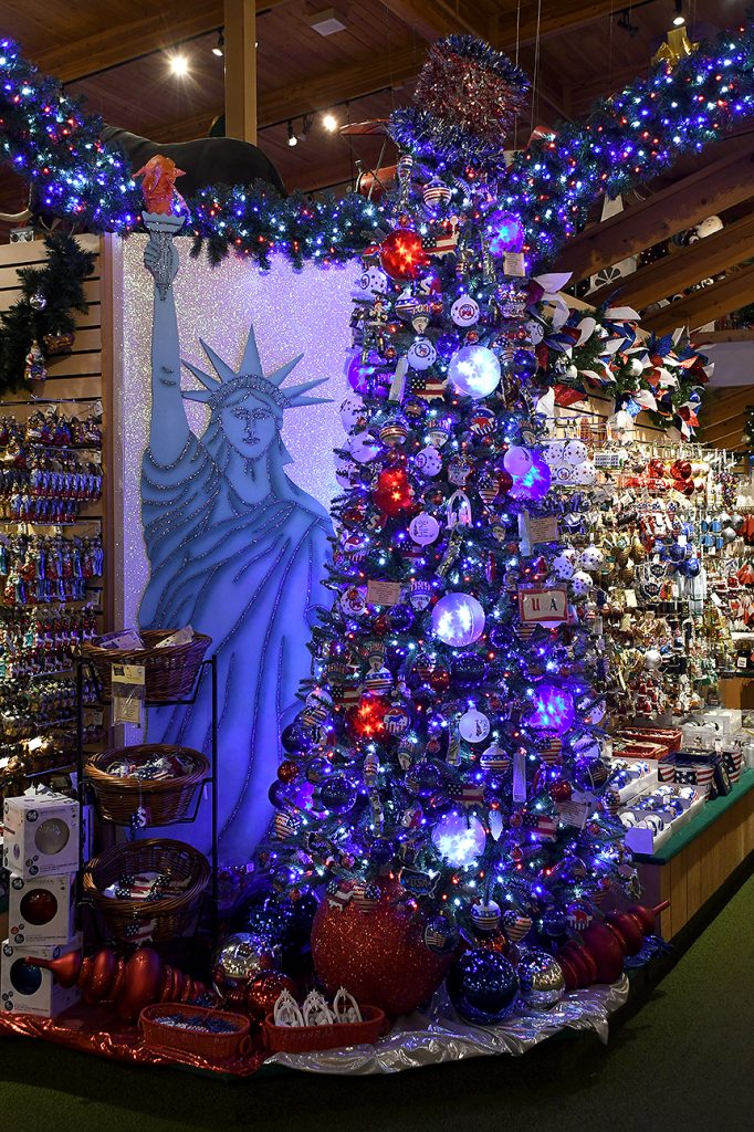 Bronner's Patriotic themed tree and custom-painted Statue Of Liberty on display in the Franknemuth, Michigan storeroom