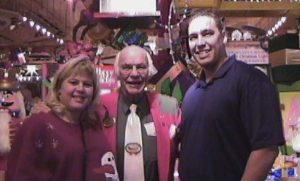 Lisa and Brad Jordan pose for a photo with Bronner's Christmas Wonderland originator, Wally Bronner.