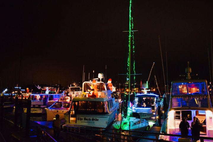 lighted and decorated boats lined up at marina for Christmas light parades