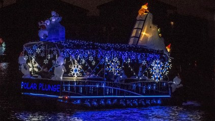 polar-plunge themed boat with polar bear and snowflake decorations and white and blue lights