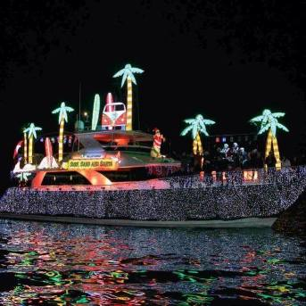 Christmas boat parades in Florida with yacht glistening with clear lights and palm-tree decorations