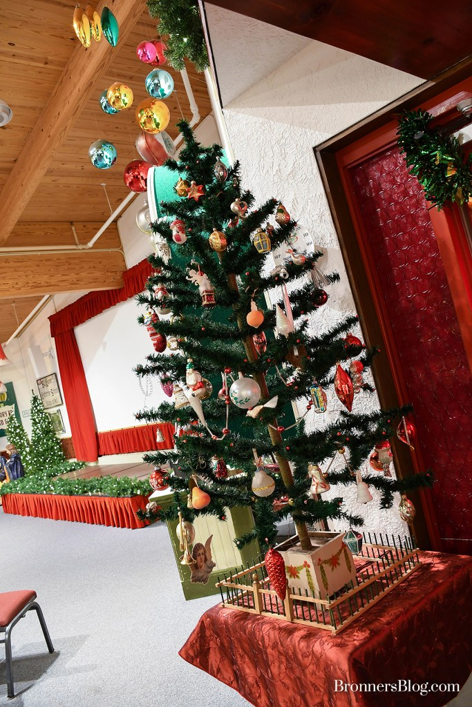 Vintage Feather Tree And Christmas Ornaments on display in the Program Center at Bronner's Christmas Wonderland in Frankenmuth, Michigan.