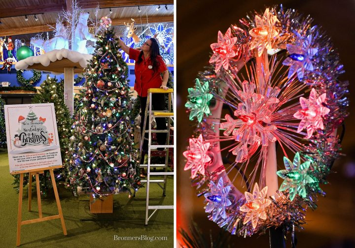 Misty from Bronner's decorating team adds the tinsel snowflake tree topper atop the Vintage Christmas tree.
