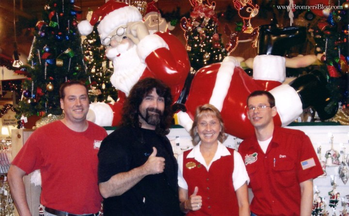 """Former WWE wrestler """"Mankind"""", Mick Foley, poses for a photo with Bronner's staff and fans."""