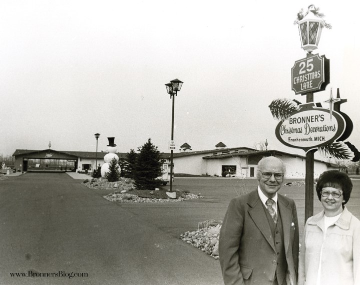 Wally and Irene Bronner stand in front of Bronner's CHRISTmas Wonderland at their new location on 25 Christmas Lane in Frankenmuth before the grand opening in 1977.
