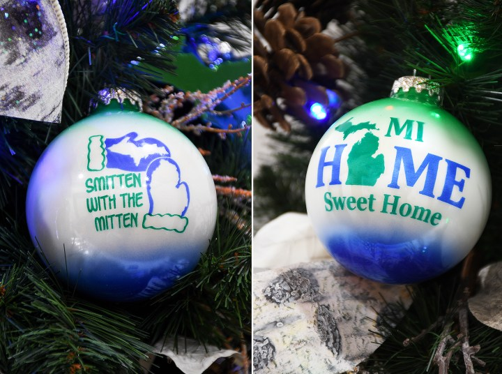 side by side photos of round glass green, blue and white glass ornaments reading Smitten with the Mitten and MI Home Sweet Home