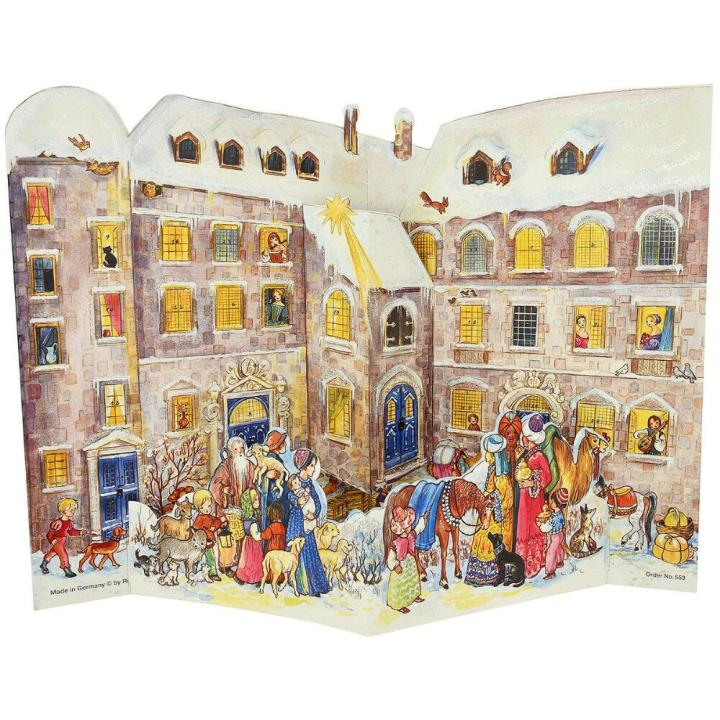 3-D Advent calendar pictures a Nativity pageant going on in front of a building in Victorian times