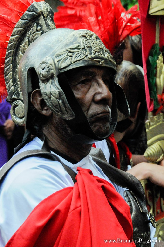 Guatemalan man dressed as a Roman soldier during a Holy Week processional in celebration of Good Friday.