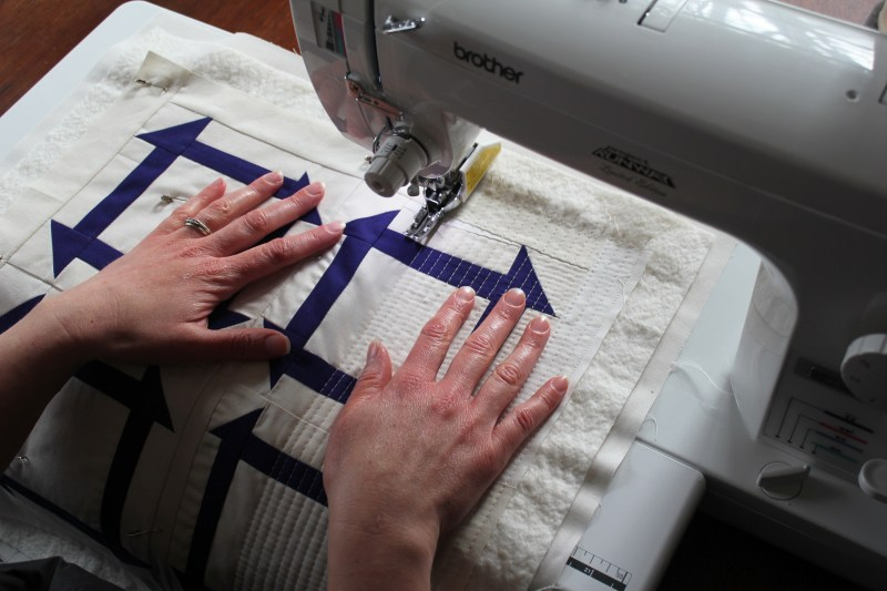 21 quilting the top