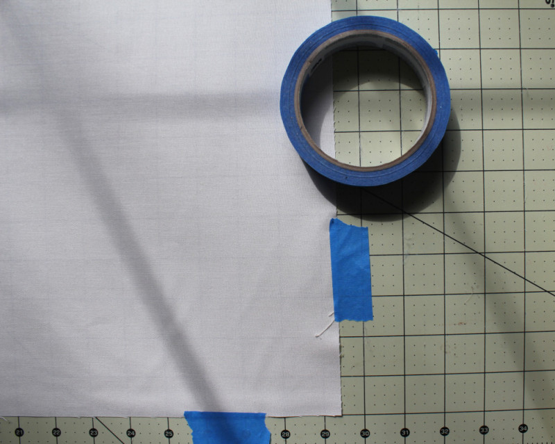 3 detail of blue tape and quilt back