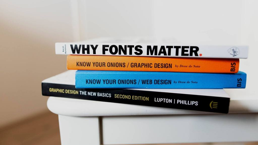 Couple of books on the importance of web design, kept on a desk