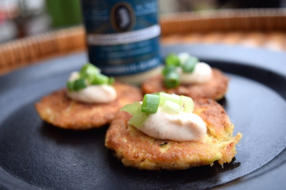 three crabcakes on a plate topped with Bubbie's hoseradish