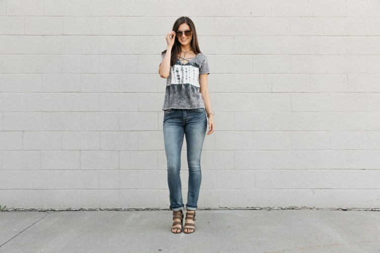 Girl in a BKE Stella Straight jean and strappy heels.
