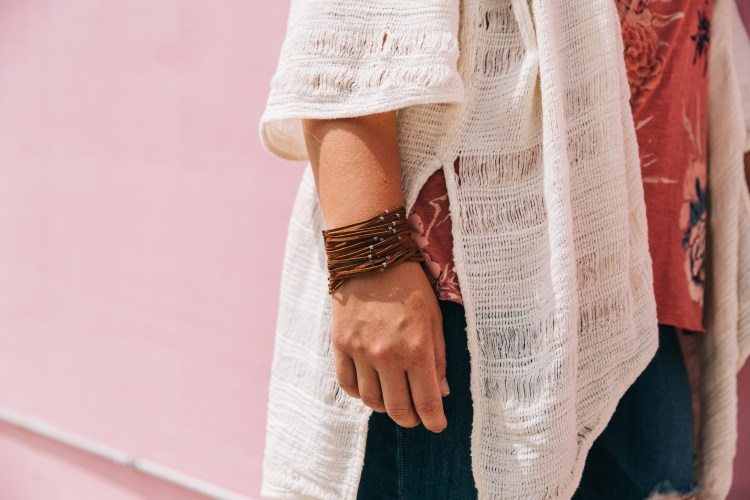 trending detailing of woven cardigan and leather bracelet with metal beads.