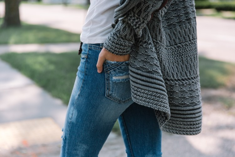Fall's Best Sweaters - cardigan detail shot with Buckle Black denim back pocket showcased.