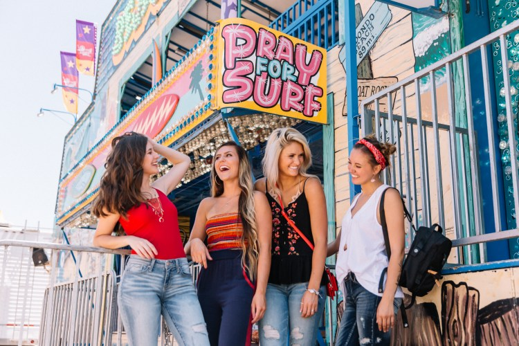 Four girlfriends head to the fair looking stylish in outfits from Buckle.
