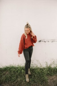 How to style black jeans - Women's Willow & Root Black Washed Distressed High Rise Mom Jeans, orange sweater, Sorel Joan of Arctic Leather Wedge II Boot