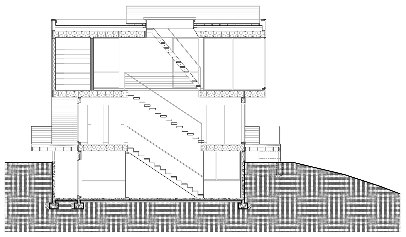 hight resolution of once inside the interior circulation stacks in order to consume as little square footage as possible a solid stair leads to the lower level while an open