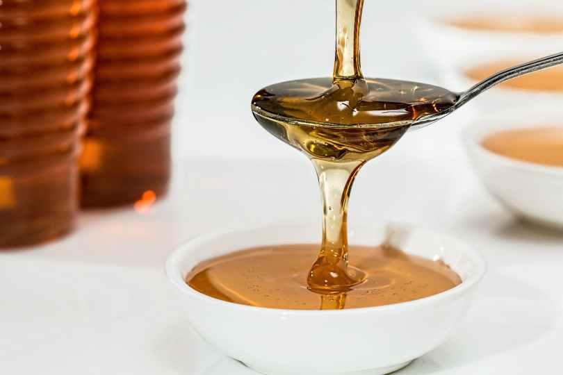 honey on white bowl