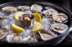 oyster-bar-raw-with-lemon-in-pan