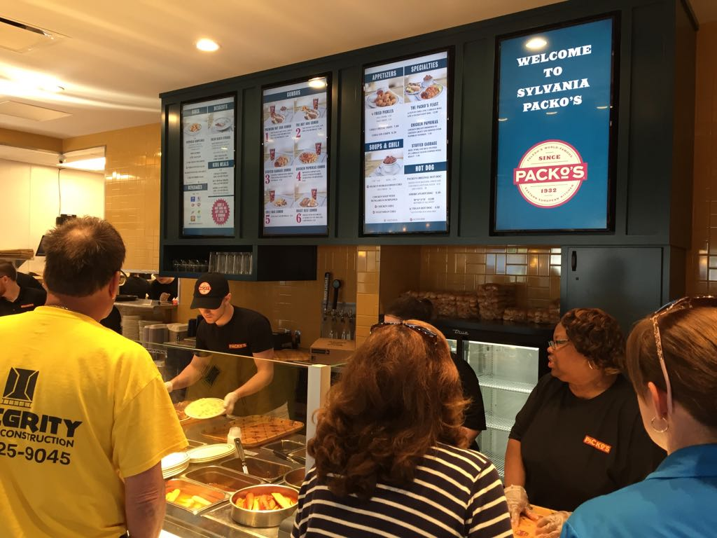 Behind counter cashier takes orders for tony packos