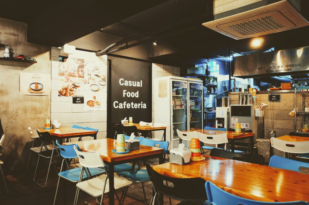 Fast casual food dining area with chairs and wooden tables