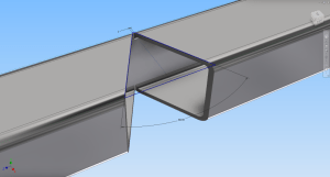 Unbent steel showing sketch for cutting.