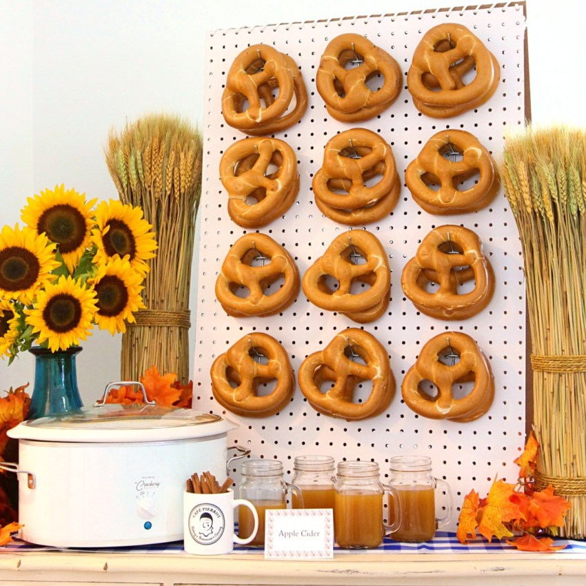 pretzel display with apple cider station for a festive fall feast in north jersey