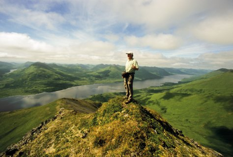 Stefan Quinth on top of a mountain overlooking Frazer Lake, Kodiak, Alaska