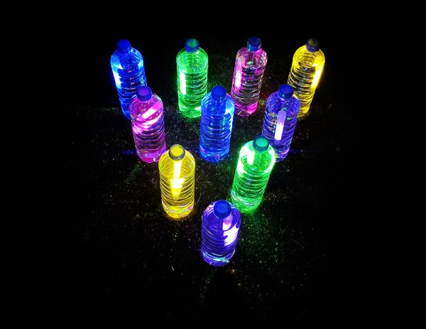 Bowling With Plastic Bottles And Glow Sticks Outside