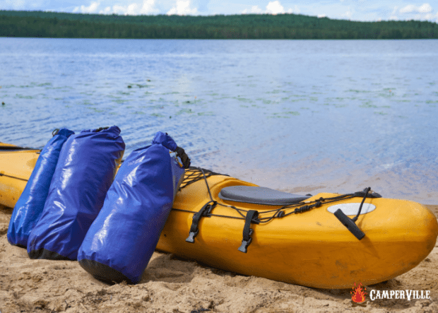 best dry bags - dry bags leaning on a camping kayak