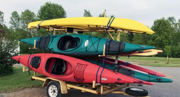 A Yellow Used Kayak Trailer Holding Five Kayaks