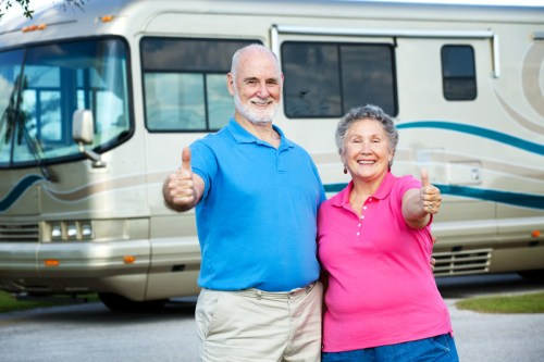 Retired Seniors Couple Standing By Their RV