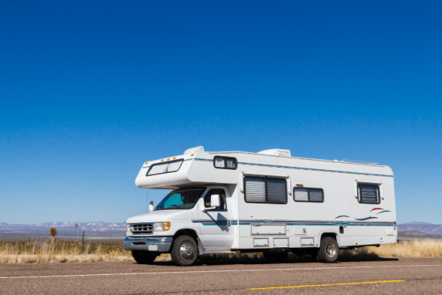 class c motorhome parked on the road