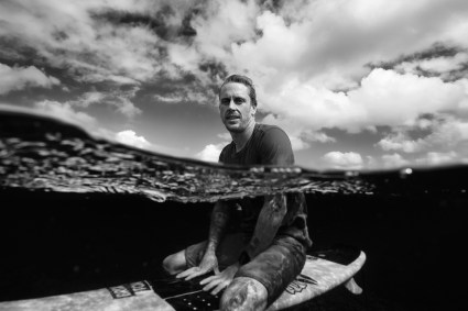 capture one raw image editor russell ord blogpost chippa wilson surfer on sitting on surfboard half submerged in the ocean