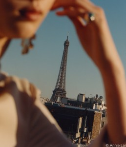 capture one RAW photo editor femininity blogpost Annie Lai close up of womans head shoulder and arm framing eiffel tower in distance for CHLOE